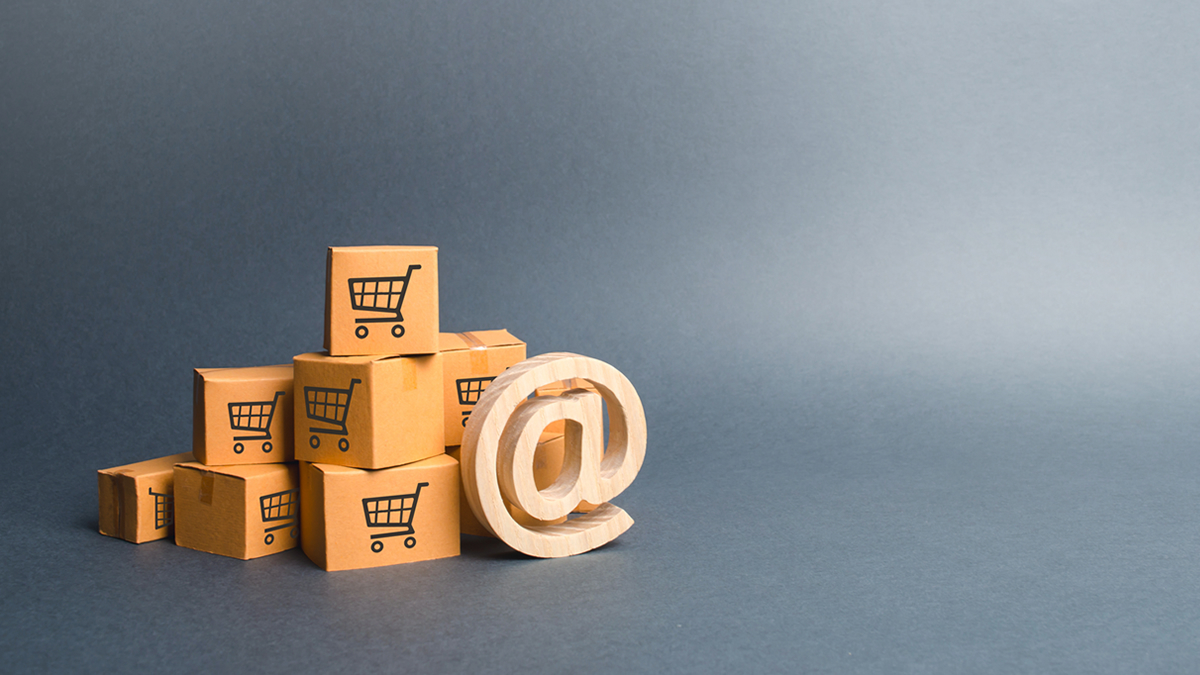 transactional email - cart symbol on boxes with wooden @ symbol