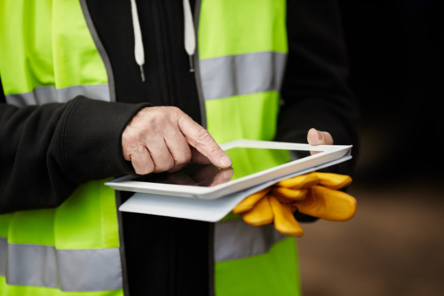 Electronic Health & Safety Management - Construction Worker with Tablet