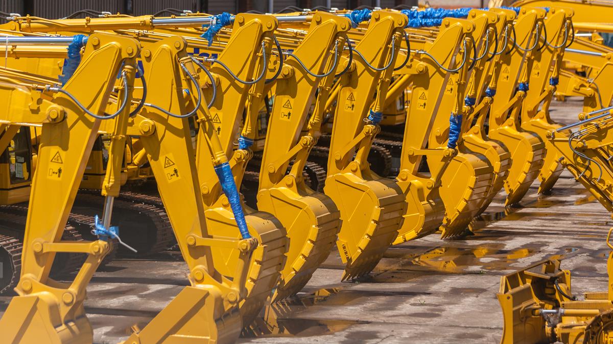 Brand new yellow excavators in a row