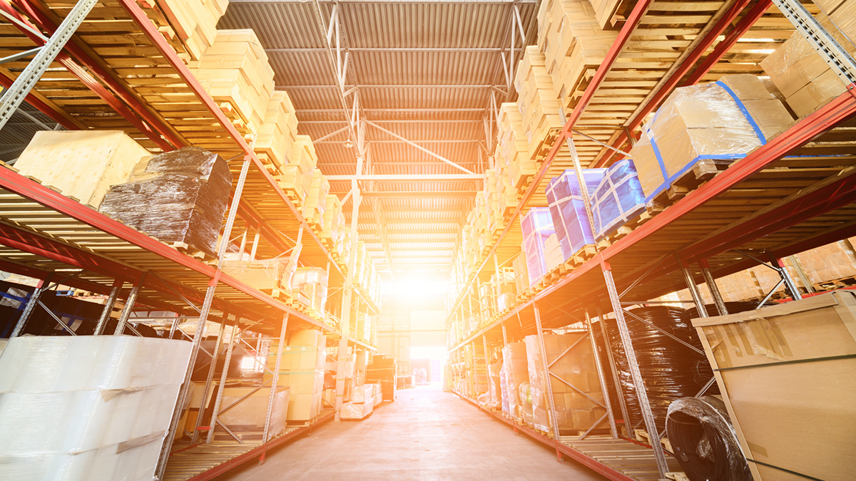 Glowing sunrise inside commercial warehouse